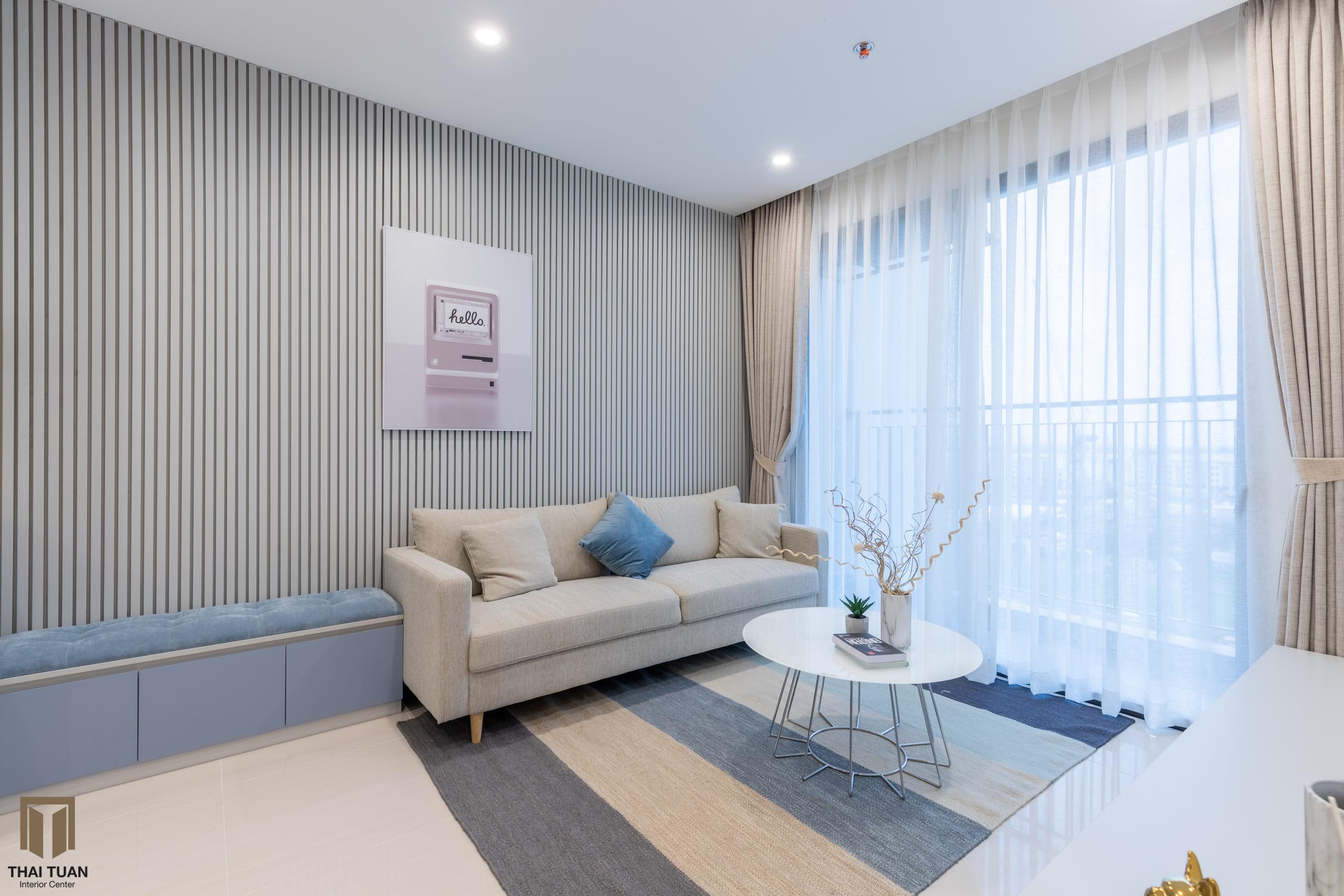Phòng khách với tone màu xanh chủ đạo