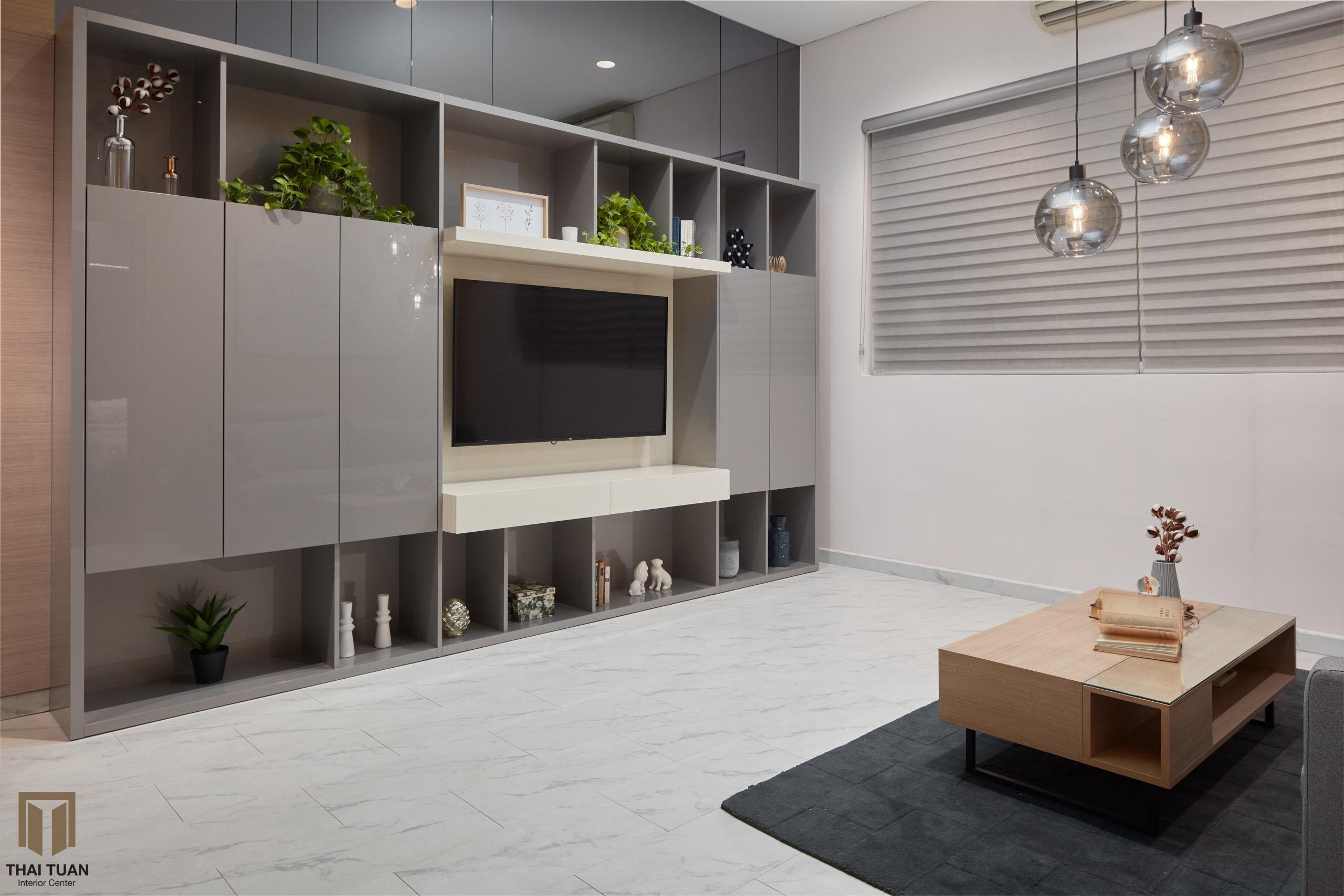 Hệ tủ TV với bề mặt Acrylic bóng gương tạo nên sự sang trọng cho không gian