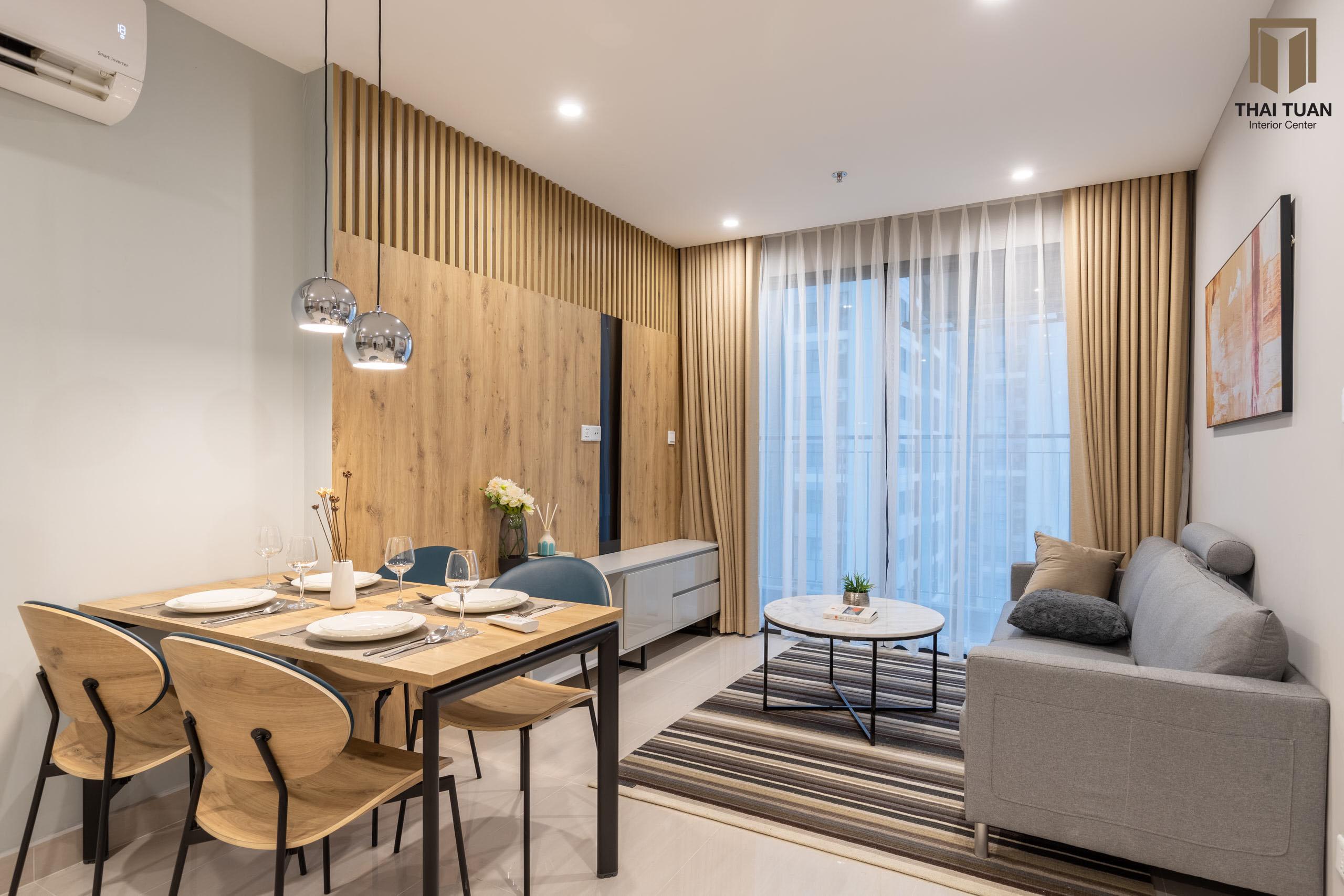 Phòng khách ăn với tone màu gỗ ấm cúng làm chủ đạo